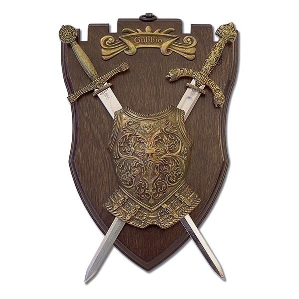Panoplia de madera con pectoral y 2 mini espadas. Medidas 25 x 16 cm. Peso 578 gr.